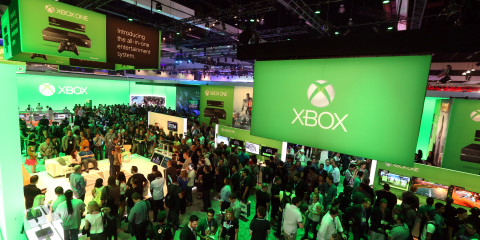 IMAGE DISTRIBUTED FOR MICROSOFT - E3 2013 attendees interact with newly announced games and experiences for Xbox One at Microsoft's booth at E3 2013 in Los Angeles on Tuesday, June 11, 2013. (Photo by Casey Rodgers/Invision for Microsoft/AP Images)